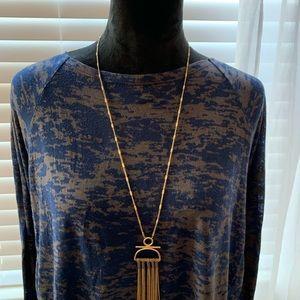 Blue long sleeve shirt.